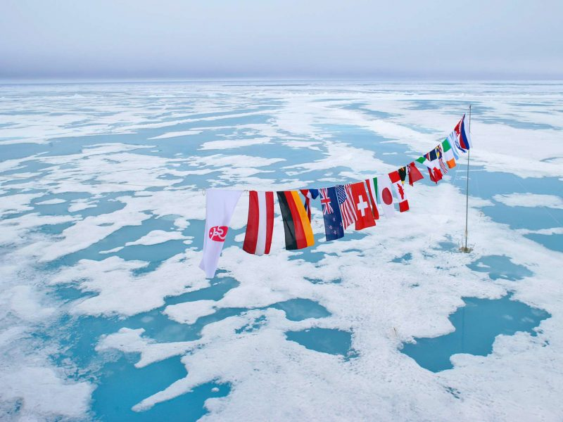 arctic multi nation flags at north pole qe